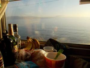 Our 'dining' table in the cabin, next to Lake Baikal, complete with Chinese beer; sold to us by the train guards