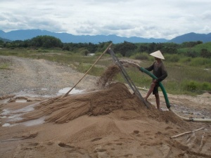 Locals harvesting sand from the river