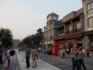 Western shopping district around Qianmen; note tram line and building marking the edge of Tiananmen Sq on the left