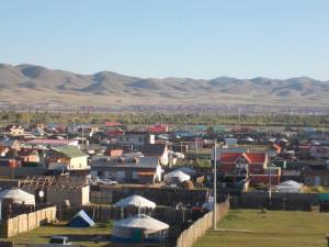 Contrast between the sprawling town of UB - which was also gripped by construction of multi-storey buildings, and the northern Mongolian hills behind